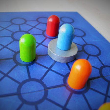 Niebieski pionek zdobywa dysk